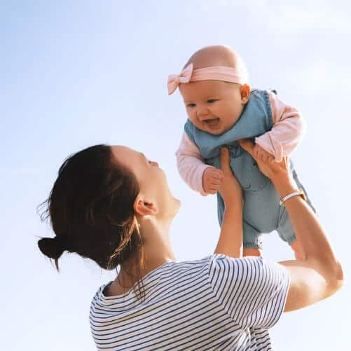 Woman playing with Baby